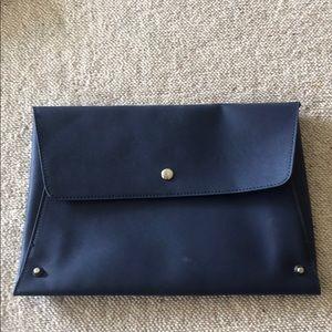 Blue faux leather clutch